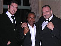 Tyson Fury (left) poses with Sugar Ray Leonard and father Johnny