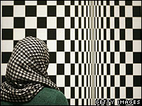 An Arabic student looks at Movement in Squares, 1961 by Bridget Riley