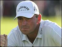 Thomas Bjorn eyes up a putt at the BMW International Open