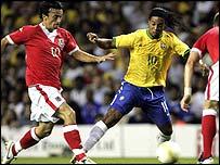 Wales midfielder Simon Davies closes down Brazil's Ronaldinho