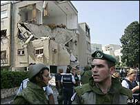 Soldiers by a damaged building, Haifa