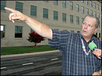 Pentagon attack survivor John Yates points out where the plane hit