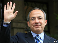 Felipe Calderon waves to supporters after the court's ruling