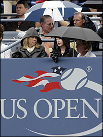 Spectators wait for the rain to stop on day nine of the US Open