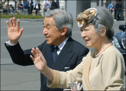 Emperor Akihito and Empress Michiko wave during a tour of Hokkaido on the day of the birth