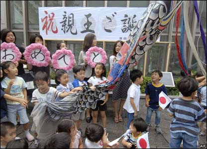 Young children at a Tokyo school prepare to fly a carp streamer to celebrate the birth
