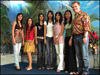 Lawrence Lynch (right) and his wife Tapanee, along with some Thai clients.