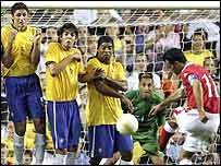 Ryan Giggs fires a free-kick at Brazil's goal