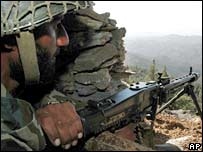 Pakistan army soldier monitors the Afghan-Pakistan border