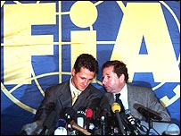Michael Schumacher and Ferrari team boss Jean Todt face the media after the German was thrown out of the 1997 world championship