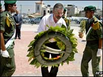 Gerry Adams at the tomb of Yasser Arafat
