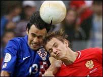 Croatia's Goran Sablic (L) and Russia's Roman Pavlyuchenko
