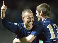 Kenny Miller celebrates his goal in Kaunas