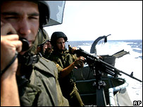 Israeli soldiers aboard naval vessel patrolling off the Lebanese coast