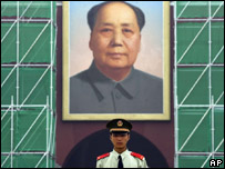 A soldier in front of Mao's portrait in Tiananmen Square