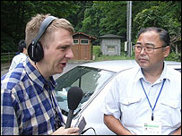 Correspondent Duncan Bartlett (l) interviews Junichiro Sawaguchi (r)