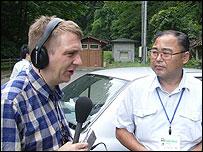 Correspondent Duncan Bartlett (l) interviews Junichiro Sawaguchi (r)