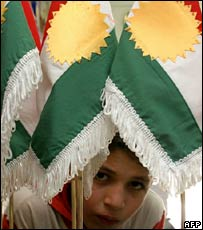 Boy with Kurdish flags in Arbil, northern Iraq
