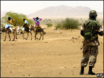 Sudanese people in Darfur and AU soldier