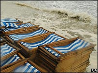 Deckchairs on the sand