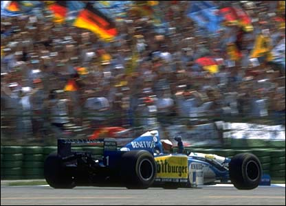 A patriotic German crowd cheer home race winner Michael Schumacher, July 1995