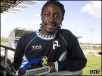 Russell Latapy with his player of the month award