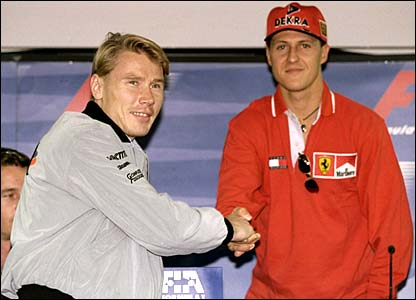 Mika Hakkinen shakes hands with Michael Schumacher