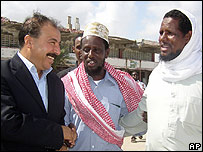 Sheikh Sharif Sheikh Ahmed (c) arrives in Libya