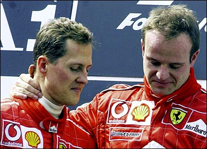 Michael Schumacher and Rubens Barrichello look embarrassed on the podium in Austria in May 2002