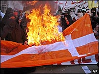 Danish flag burned in Pakistan in a protest over cartoons depicting the Prophet Muhammad in February 2006