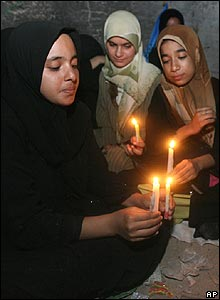 Pilgrims light candles to mark the birth of one of Shia Islam's founders