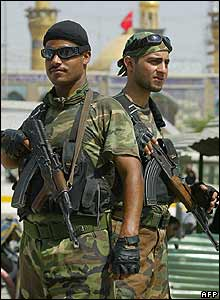 Iraqi army soldiers patrol Karbala