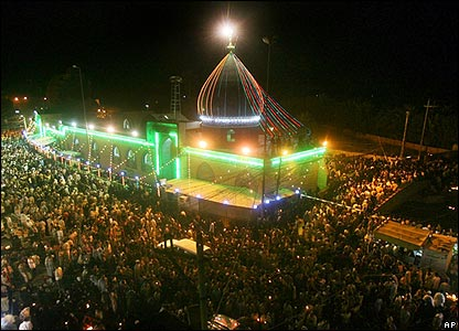 Pilgrims gather outside a mosque in Karbala before dawn