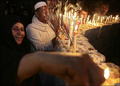 Pilgrims light candles at the Imam Mahdi shrine in Karbala