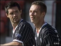 Gary Mason and Darren Young celebrate for Dunfermline