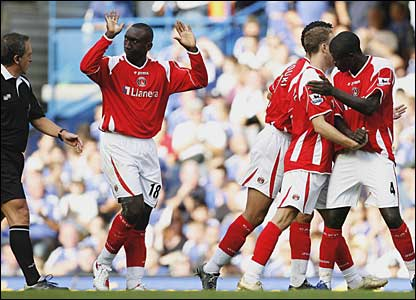 Jimmy Floyd Hasselbaink salutes the crowd after scoring for Charlton