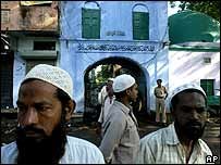 Muslims stand outside the Hameediya Mosque, the scene of bomb explosions in Malegaon