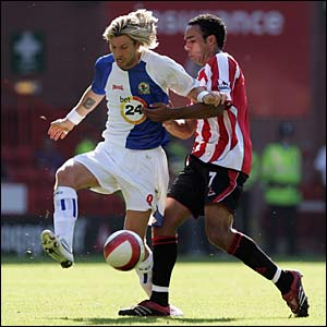 Robbie Savage and Paul Ifill tussle at Bramall Lane