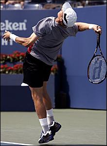 Nikolay Davydenko serves to Roger Federer