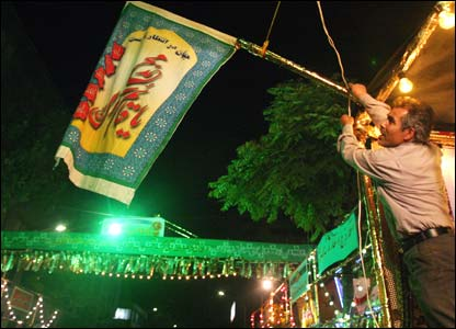 Street decorations being put up in downtown Tehran on Saturday