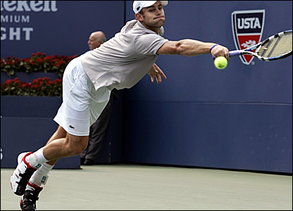 Andy Roddick stretches to hit a return