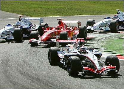 Nick Heidfeld attempts to overtake Michael Schumacher (centre) while Raikkonen leads