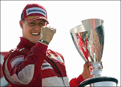 Schumacher holds the winner's trophy aloft