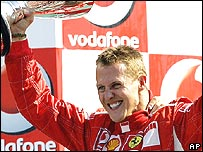 Michael Schumacher celebrates a win that leaves the title race finely poised