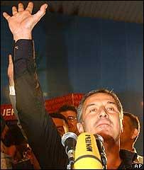 Montenegrin Prime Minister Milo Djukanovic waving