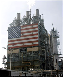 An oil refinery in California displays the US flag