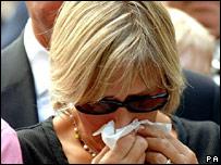 Mourner at memorial
