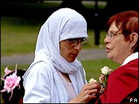 People in Beeston, Leeds, on the first anniversary of the London bombings