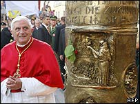 Pope admires bronze column