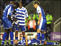 Reading players surround Ivar Ingimasson after his winning goal